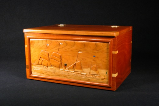 The Belganland on a large mahogany chest