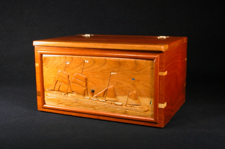 The Belganland on a large mahogany chest